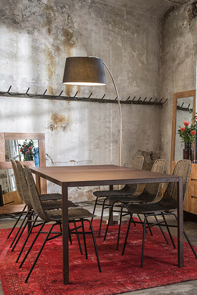 image of a table and chairs by Pilma's furniture brand, PLM Design.